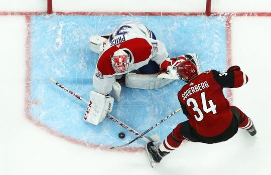 Canadiens goaltender Carey Price blocks a shot from Coyotes center Carl Soderberg during a game Oct. 30 at Gila River Arena.