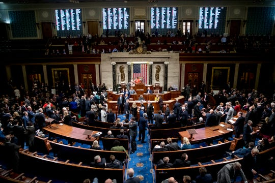 Vote tallies are displayed as House members vote on a resolution on impeachment procedure on Capitol Hill in Washington on Oct. 31, 2019. The resolution passed 232-196.