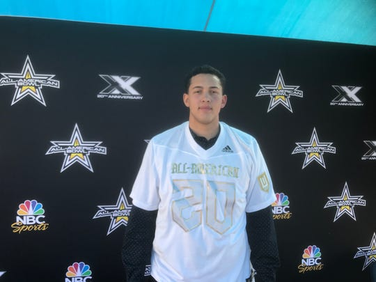 Pinnacle offensive lineman Tosh Baker receives his All-American Bowl jersey.