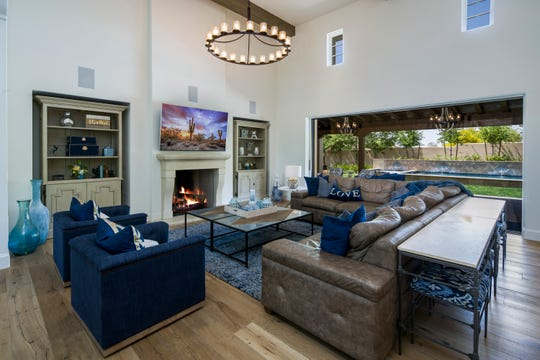 The $3.34M estate, sold by Adam and Nichole Stine, has a pocket door system in the great room that connects the home's indoor and outdoor space.