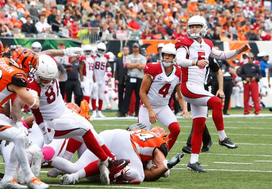 Cardinals kicker Zane Gonzalez (5) watches a field goal against the Bengals late in the first half of a game Oct. 6 at Paul Brown Stadium.