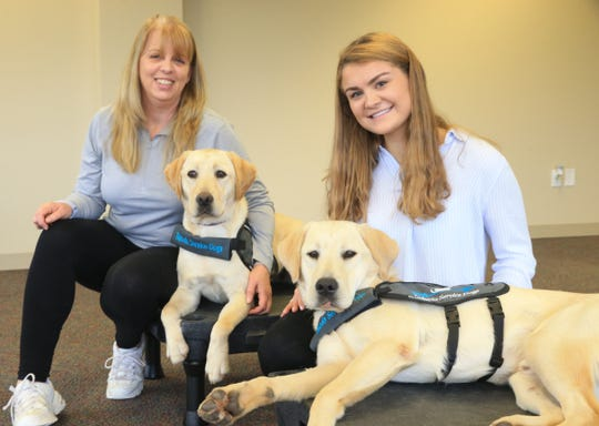 From left, Sherry Burger, Takoda Service Dogs CEO & founder and Ashley Jordan, Marist College senior & Takoda Service Dogs volunteer with, from left, Glory and Raider on October 30, 2019.