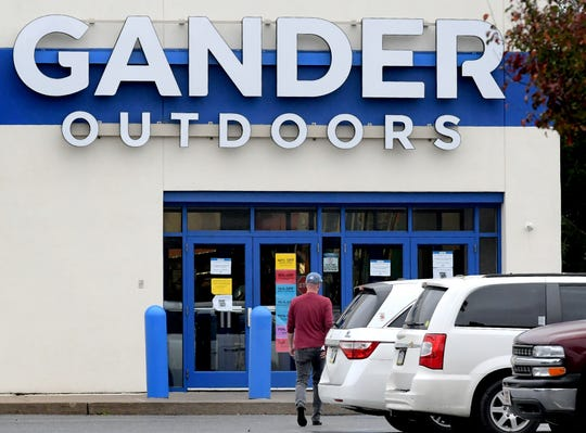 A person walks toward Gander Outdoors in West Manchester Township Thursday, Oct. 31, 2019. The future of the business is in question after parent company Camping World announced a plan to prioritize stores that sell and service RV equipment. Bill Kalina photo