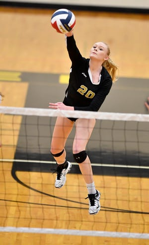 Delone Catholic's Brooke Lawyer drives a kill across the net against York Catholic during the District 3 Class 2-A girls' volleyball semifinal, Thursday, October 31, 2019.John A. Pavoncello photo
