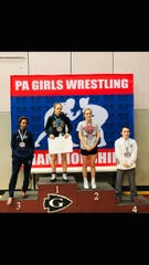 Carly Gross, middle right, finished second at the Pennsylvania girls' wrestling championships.