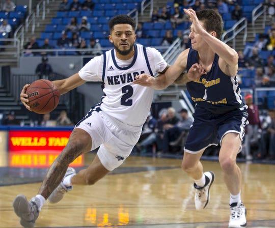 Nevada's Jalen Harris drives past Colorado Christian's Aiden Cantwell during the second half of Wednesday's exhibition game.
