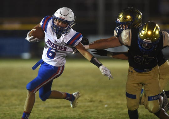 Reno's Brett Hamlin runs while taking on Reed during their football game in Sparks on Oct. 18, 2019.