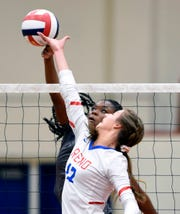 Reno's Rian Finley goes up at the net against McQueen's Maya Aiyuk at Reno High School on Tuesday. Reno won 3-0.