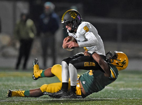 Galena quarterback Alex Laird is sacked by Bishop Manogue's Jon Brown late in the first half of Monday's game at Bishop Manogue.