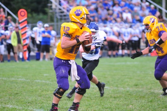 Hagerstown quarterback Noah Snodgrass (12) scored three touchdowns in the Tigers' 28-14 win over Oldenburg Academy last week. Snodgrass has thrown for 869 passing yards and scored 11 total touchdowns on the season.