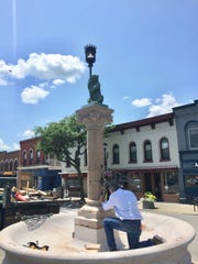 From 2017: Dick Cann of New Jersey's Moorland Studios works on the bear fountain on Main Street, Geneseo.