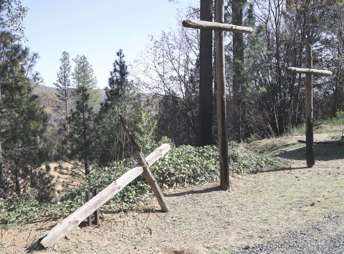 The Camp Fire burned behind the Magalia Community Church, scorching the three wooden crosses behind the church, knocking over the one on the left.