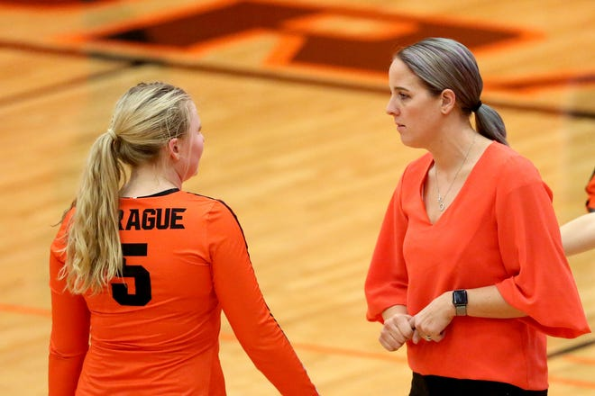 Sprague's Reese Sherwood, 5, talks with head coach Anne Olsen in the Glencoe vs. Sprague OSAA Class 6A first round of the state playoffs volleyball match at Sprague High School in Salem on Oct. 30, 2019. Sprague won in three sets.