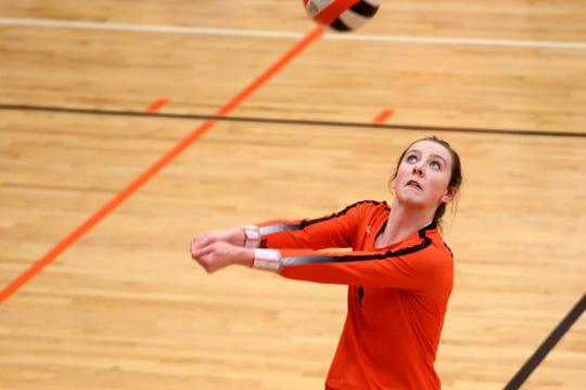Sprague's Bridgette Smith, 1, eyes the ball in the Glencoe vs. Sprague OSAA Class 6A first round of the state playoffs volleyball match at Sprague High School in Salem on Oct. 30, 2019. Sprague won in three sets.