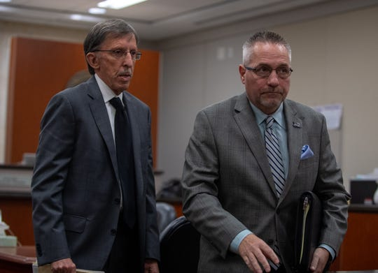 Neil Kitchens, right, walks next to his attorney as his preliminary hearing comes to a conclusion on Thursday, Oct. 31. 2019 in Salinas, Calif.