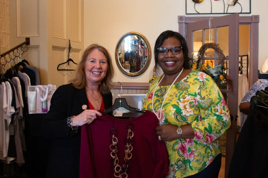 Md. State Senator Mary Beth Carozza, R-38-Worcester (left) and Orlena Wilkes pose with a shirt that Carozza decided to purchase during a visit to Wilkes' boutique on Oct. 31, 2019. Carozza said that she's shopped at the boutique in the past and is happy to encourage people to visit the store.