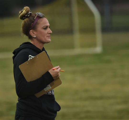 Washington field hockey coach Erica Henderson watches her team during the 1A East Section II Regional Championship on Wednesday, Oct. 30, 2019.
