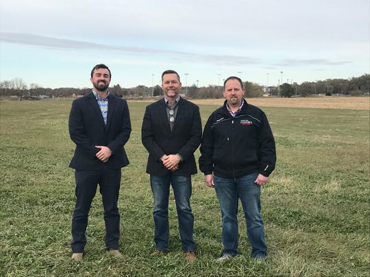 Ryan Patrick of Great Plains Sponsorships, Todd Stone of Stone Group Architects and Bryan Seaver from the Brandon Valley Hockey Association stand at the site of the proposed new hockey facility in Aspen Park.