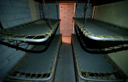 Cots inside a bomb shelter believed to have been built in the late 1950s or early 1960s in the basement of a house at 1235 E. Walnut St.