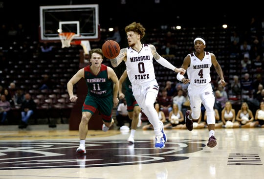 Missouri State University junior Tyrik Dixon drives down court with the ball as the Bears take on the Washington University Bears on Wednesday, Oct. 30, 2019.