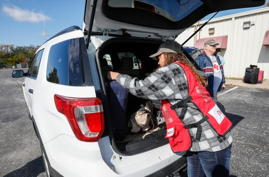 Freda Dennis loads her luggage into a Red Cross vehicle before she leaves for the airport to fly to California to help with the wildfires on Thursday, Oct. 31, 2019.