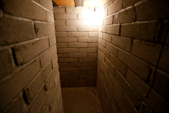 A brick hallway leading to a bomb shelter believed to have been built in the late 1950s or early 1960s in the basement of a house at 1235 E. Walnut St. in Springfield, Mo.