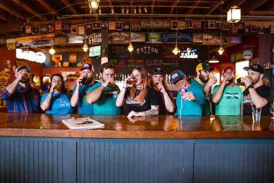 A recent publicity photo shows members of the Springfield Craft Beer Collective sharing a toast at Patton Alley Pub in downtown Springfield, Missouri.