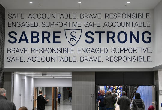 The entry to Sartell High School's main gym features printed slogans as people enter for an event Tuesday, Oct. 29, 2019, in Sartell.