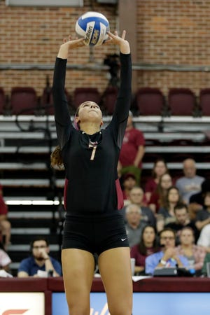 Florida State Seminoles setter Lily Tessier (7) back sets the ball to the right side hitter. The Seminoles beat the Miami Hurricanes after a hard fought four set game on Wednesday, Oct. 30, 2019.