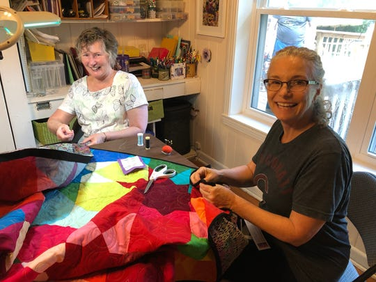 United Church of Tallahassee quilters Jane Kazmer and Polly McAuliffe.