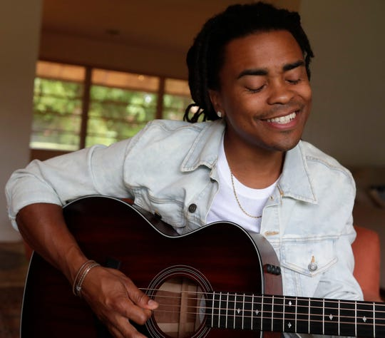 "Royce Lovett, a contestant on ""The Voice"" and resident of Tallahassee, performs an original song titled ""Canopy Roads"" on Tuesday, Oct. 29, 2019."