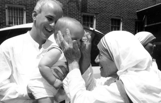 JIm Towey with Mother Teresa blessing a child.