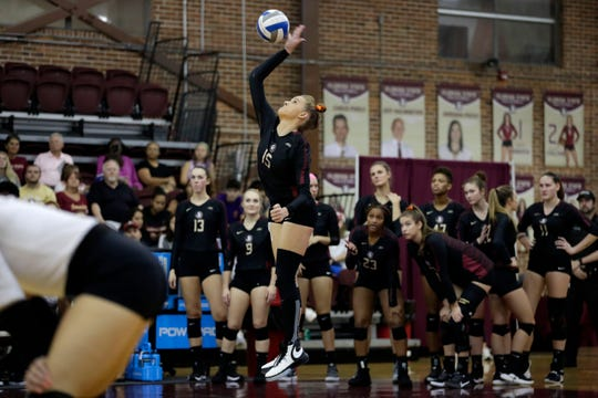 Florida State Seminoles outside hitter Payton Caffrey (15) serves. The Seminoles beat the Miami Hurricanes after a hard fought four set game on Wednesday, Oct. 30, 2019.