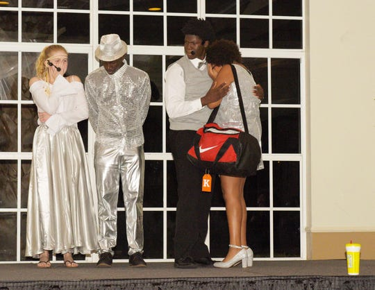 "Sophia Olsinski, left, Jevaughn Estime, Sean Celestin and Korhyn Furrowh perform at the END It! Mystery Dinner Theater fundraiser ""The Last Groove Goes Platinum"" in Port St. Lucie on Oct. 19, 2019."