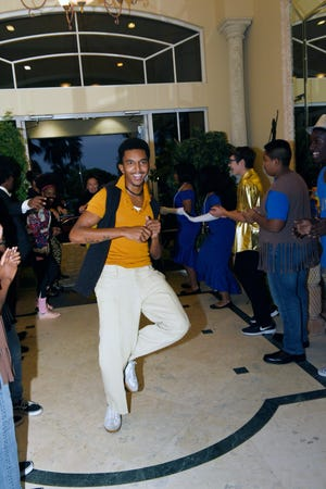 """Deyvon Sanders dances down the Soul Train line at the END It! Mystery Dinner Theater fundraiser, """"The Last Groove Goes Platinum"""" on Oct. 19, 2019."""