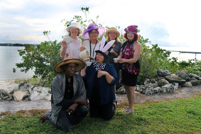 Learn to Read of St. Lucie County volunteers, standing, from left, Karen Kennedy, Mary Kelly, Lisa Strouss and Debra Terrio with George Bussey, kneeling, and Crystal Samuel are getting in character for the Nov. 23 Downtown Abbey to Mad Hatter High Tea at the Fort Pierce Yacht Club.