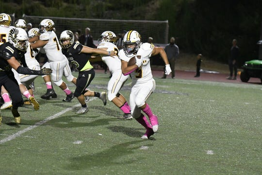 Elijah Leiva had three touchdown runs to lead Simi Valley to a first-round win on the road.