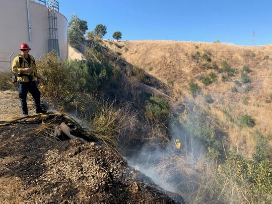 Crews responded to a brush fire Thursday afternoon in Santa Paula as they got a handle on the Easy Fire in Simi Valley.