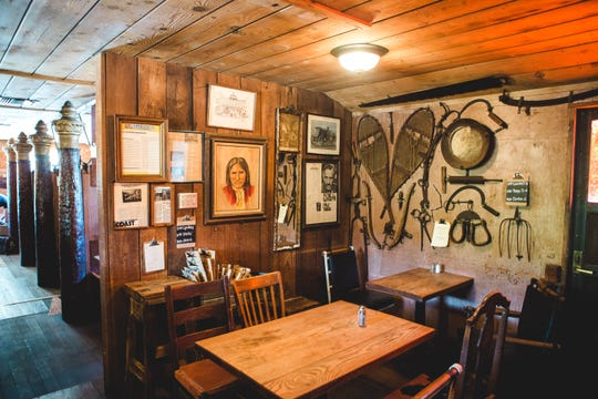 Salvaged items make up the decor at The Old Place in Cornell, where timed, by-reservation seatings are available for the restaurant's three tables and five booths. Seating is first-come, first-served at the 30-foot bar, not shown.