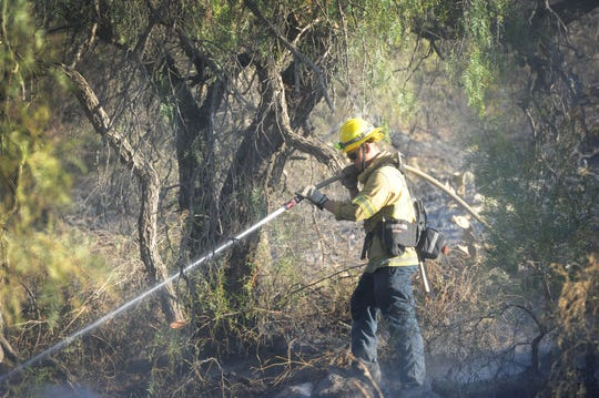 Firefighters on Thursday continued mop-up work in areas along Tierra Rejada Road that burned in the Easy Fire on Wednesday in Simi Valley.