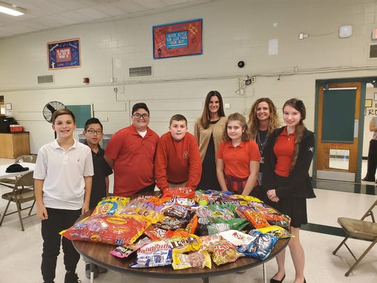 """(Back row, from left) Suzette DeMarchi, principal, and Kristina Craig, vice principal, Vineland High School, are pictured with the top """"candy collectors"""" for the October kindness project for Vineland's Applied Math and Science Academy at Johnstone."""