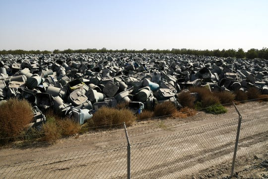 In a cruel irony, Visalia split recycle cans are likely destined for the county landfill. Roughly 30,000 cans await their fate in a 5-acre lot beside the city's wastewater treatment plant on Oct. 30, 2019.