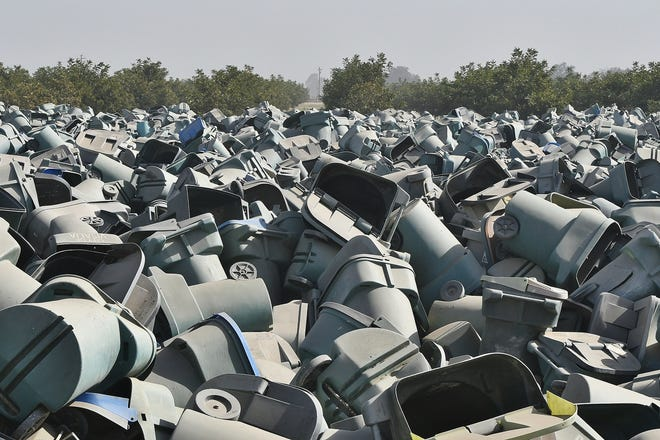 In a cruel irony, Visalia split recycle cans were destined for the county landfill. Roughly 30,000 cans await their fate in a 5-acre lot beside the city's wastewater treatment plant on Oct. 30, 2019.