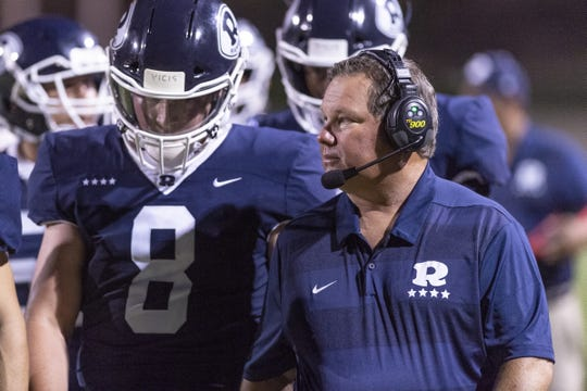 Redwood head coach Kevin Scharton, right, against Dinuba at Mineral King Bowl in a non-league football game on Friday, August 30, 2019.