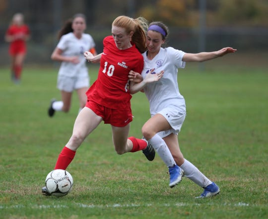 North Rockland's Kelly Brady works for possession against New Rochelle's Hailey Young (15) during their 3-0 win in the Section 1 girls Class AA soccer semifinal game at North Rockland High School in Thiells on Thursday, October 31, 2019.