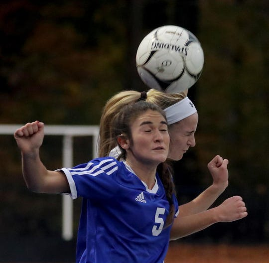 Mary Windram of Pearl River battles Claire Gardner of Albertus Magnus during a Section 1 Class A girls' soccer semifinal game at Pearl River High School Oct. 31, 2019. Pearl River defeated Magnus 1-0 in overtime.