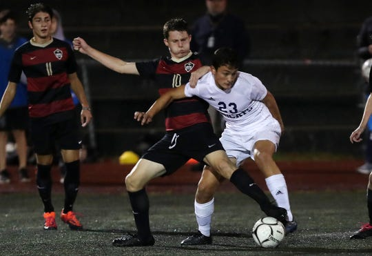 Rye's Jake Creus (10) and Byram Hills' Benjamin Hammond (23) battle for ball control during the Section 1 Class A semifinal at Rye High School Oct. 30, 2019. Rye won the game 4-2.