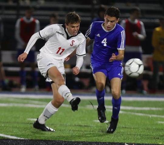 Somers' Daniel Dippolito is pressured by Pearl River's John Branca during their Class A semifinal at Pearl River Oct. 30, 2019. Somers won 4-2.