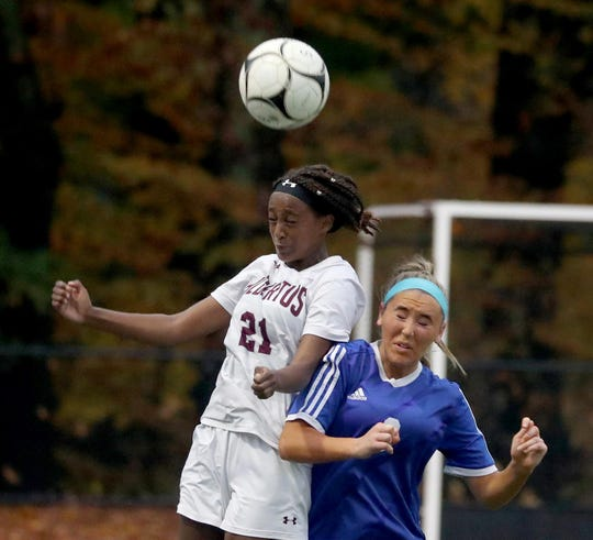 Mihret Smith of Albertus Magnus battles Kylie McMally of Pearl River during a Section 1 Class A girls' soccer semifinal game at Pearl River High School Oct. 31, 2019. Pearl River defeated Magnus 1-0 in overtime.