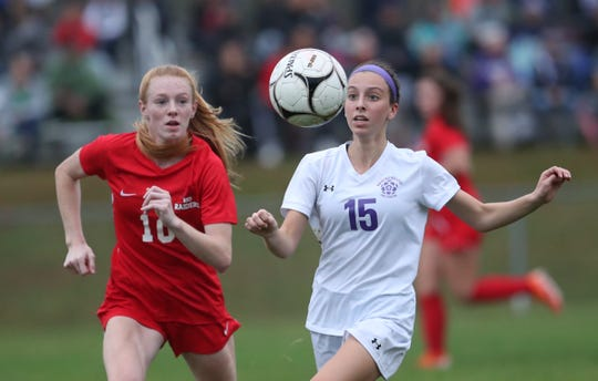 New Rochelle's Hailey Young (15) looks to keep the ball from North Rockland's Kelly Brady (10) during the Section 1 girls Class AA soccer semifinal game at North Rockland High School in Thiells on Thursday, October 31, 2019.